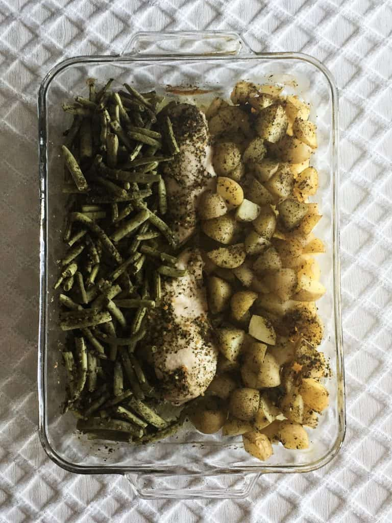 chicken green beans and potatoes baked in a glass casserole dish