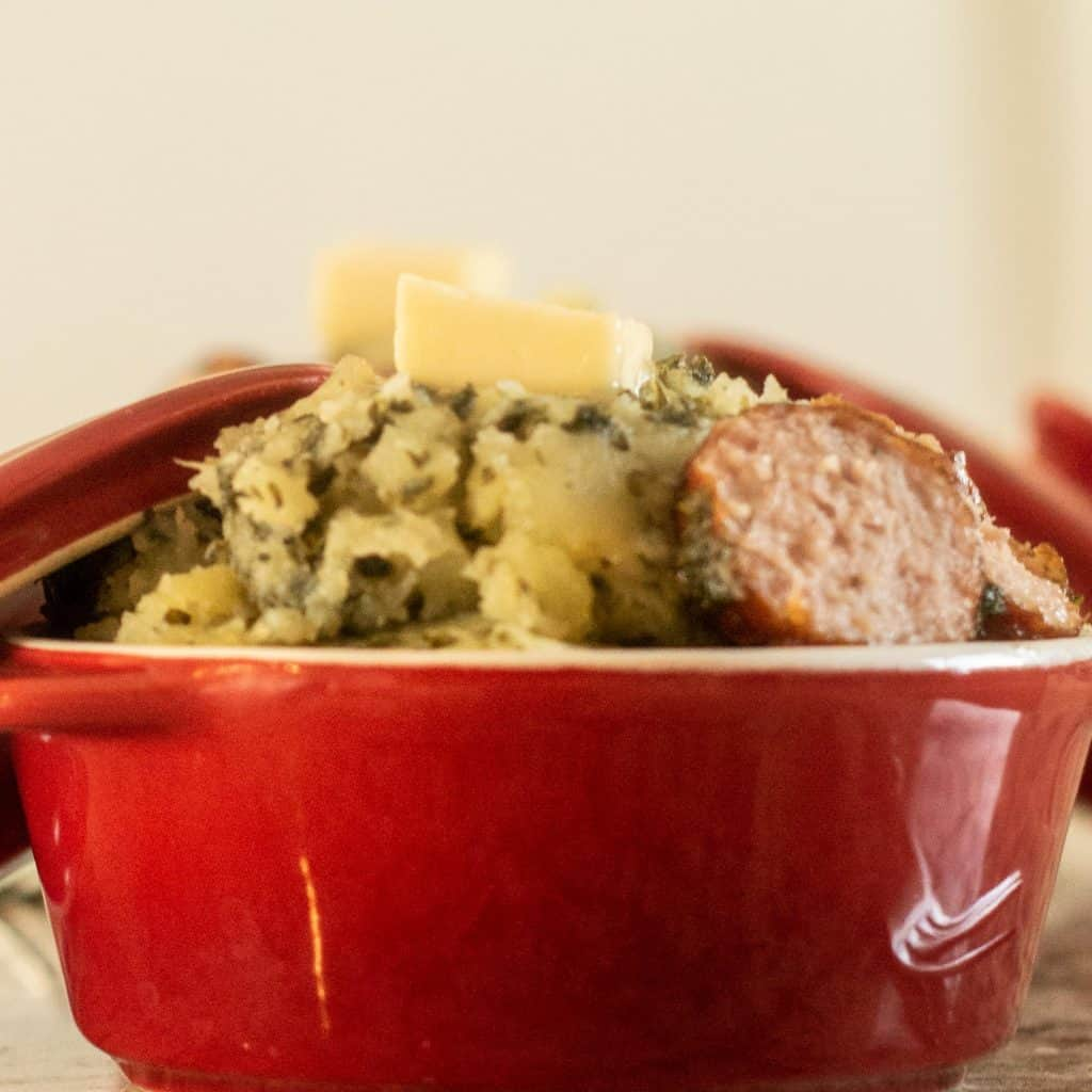 Potatoes and Kale Mash in a red bowl